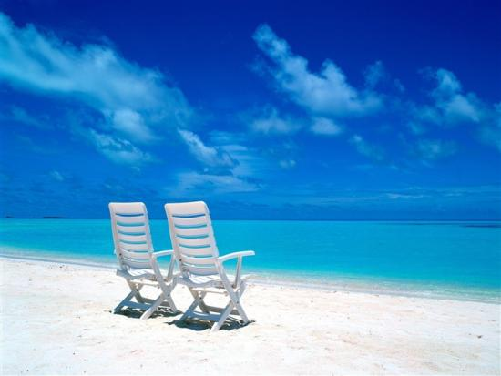 two_beach_chairs_on_the_beach_wallpaper_medium